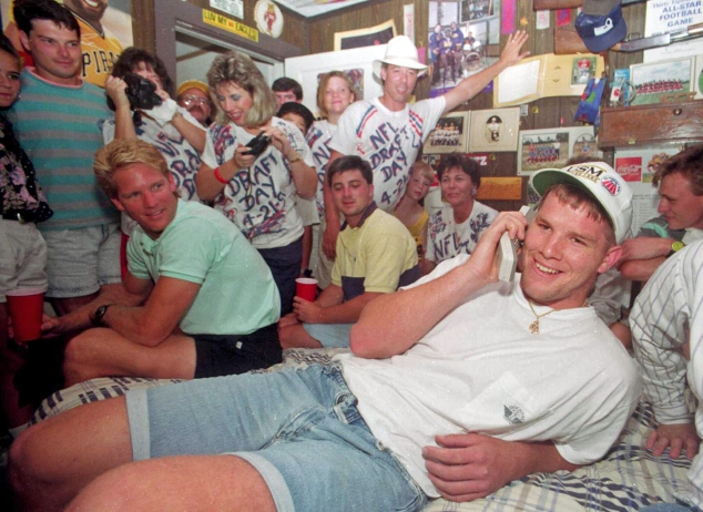 Brett Favre takes a phone call from the Atlanta Falcons on NFL draft day on April 21, 1991. (Tim Isbell/AP Photo, Sun Herald)